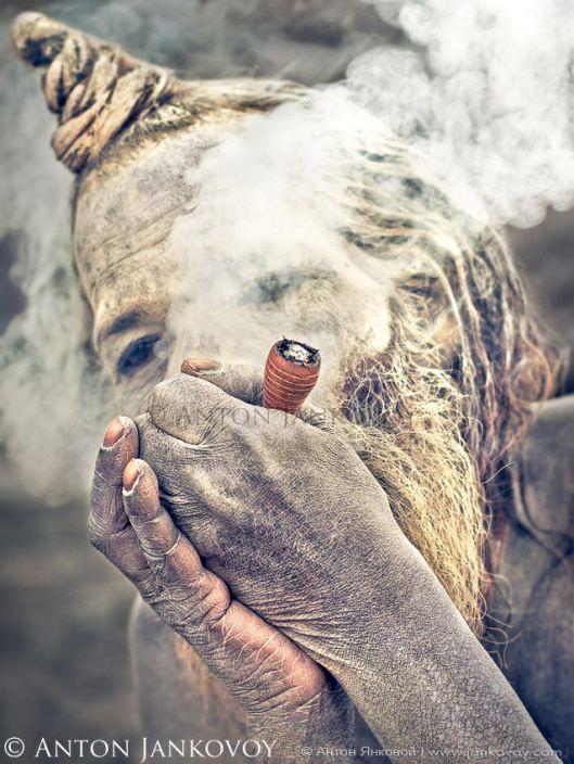 Sadhu smoking hashish.