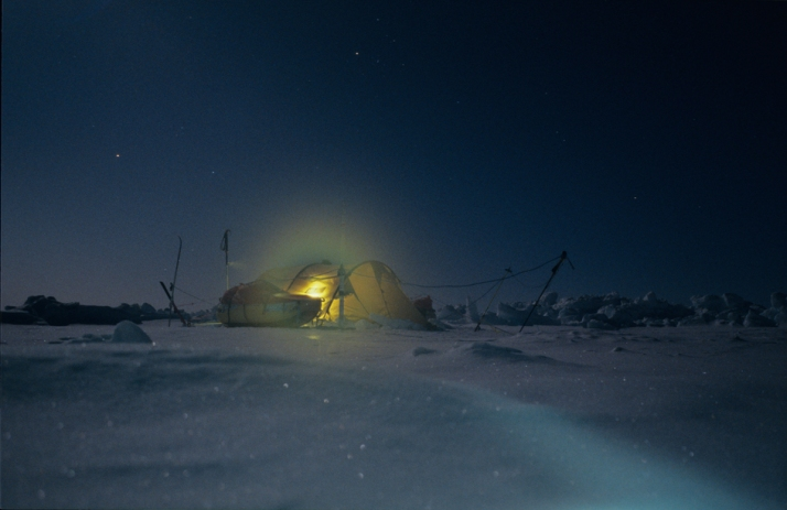 Arctic mood by light inside the tent, and moonlight outside.
