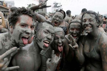 Foreign tourists covered in mud during the Boryeong Mud Festival.
