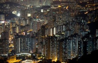 This Nov. 27, 2015 photo shows apartment buildings in Hong Kong. In tightly-packed Hong Kong, the dead are causing a problem for the living. Limited land to build on and soaring property prices mean Hong Kong is fast running out of space to store the dead.  (AP Photo/Kin Cheung)