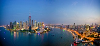 China Shanghai town city blocks of flats high-rise buildings city skyline Huangpu river flow Pudong evening travel traveling